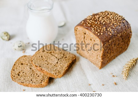 Sliced bread with fresh coriander and milk