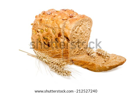 Sliced bread with nuts and ears - stock photo
