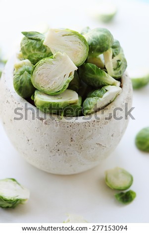 sliced brussels sprouts in ceramic vase - stock photo
