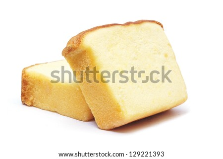 Sliced butter cake on white background