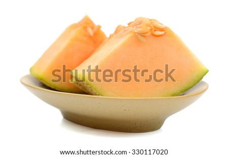 sliced cantaloupe melon on plate isolated on white