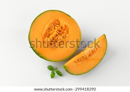 sliced cantaloupe melon on white background - stock photo