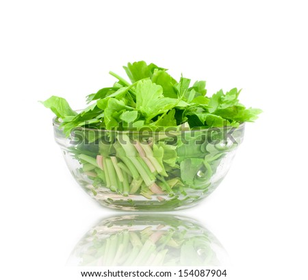 Sliced �¢??�¢??celery in a cup on white background