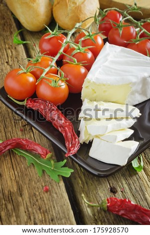 sliced cheese, bread and tomatoes on the table