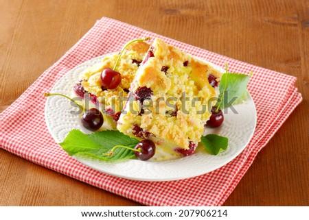 sliced cherry pie on white plate and checkered napkin - stock photo