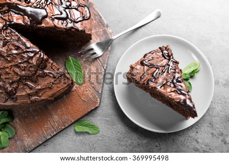 Sliced chocolate pie in plate, closeup - stock photo