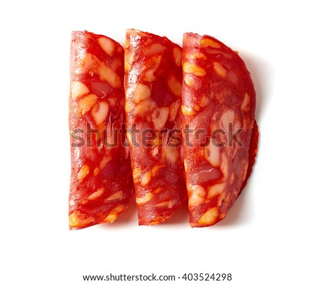Sliced chorizo sausage isolated on white background, top view - stock photo