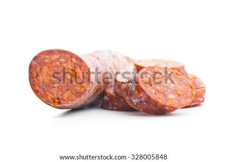 sliced chorizo sausage on white background - stock photo