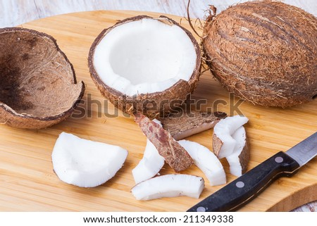 sliced ??coconut on wooden background - stock photo