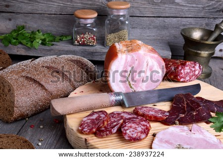 Sliced cold meats on a cutting board - stock photo