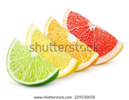 Sliced colorful citrus fruit - lime, lemon, orange and grapefruit isolated on white - stock photo