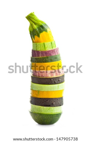 Sliced  Courgette (Zucchini)  and Eggplants with water drops /  Colorful vegetable's concept /  isolated over white background - stock photo