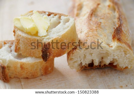 Sliced Croquise French Baguette with Butter - stock photo