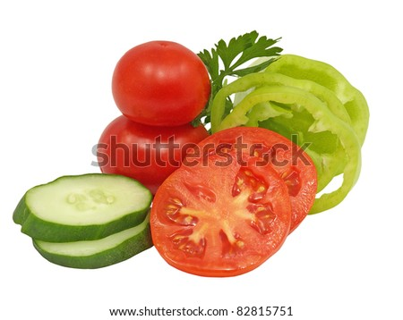 Sliced cucumber, green pepper and tomato isolated on a white background.