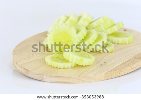 Sliced cucumber on cutter board