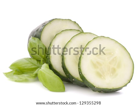 Sliced cucumber vegetable and basil leaves still life isolated on white background cutout - stock photo