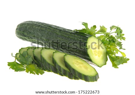 Sliced cucumber with green parsley isolated on white background