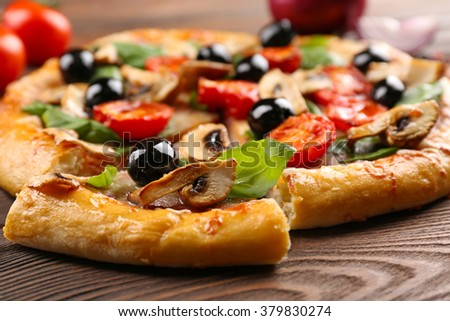 Sliced delicious tasty pizza, closeup - stock photo