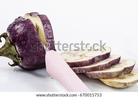 sliced eggplant with knife