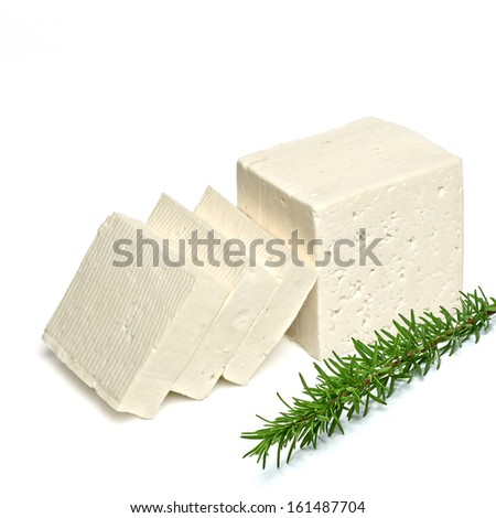 Sliced feta cheese with rosemary branch on white background  - stock photo