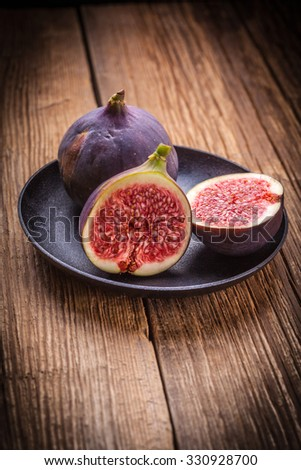 Sliced figs on a wooden table. Shallow depth of field.