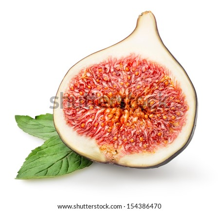 Sliced figs with green leaf isolated on white