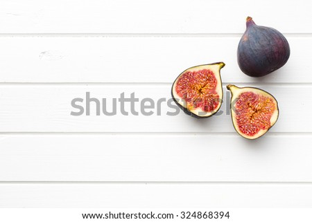 sliced fresh figs on kitchen table - stock photo