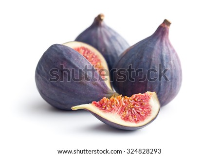 sliced fresh figs on white background