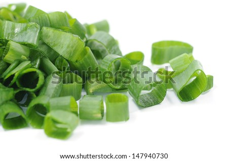 sliced fresh onion leaf on white