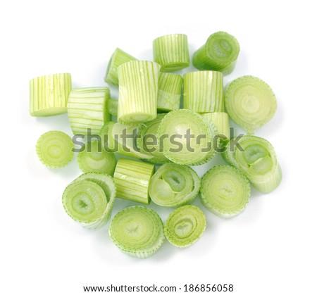 sliced fresh onion leaf on white background  - stock photo