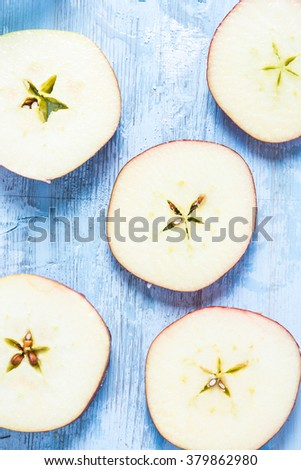 Sliced fresh organic apple on table, lay flat from above. - stock photo