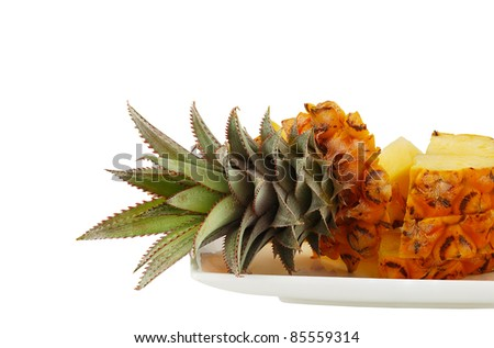 Sliced fresh pineapple on white plate isolated on white background - stock photo