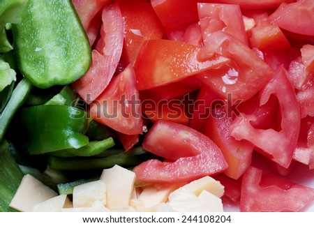 Sliced Fresh Tomatoes With Green Pepper and Cheese - stock photo