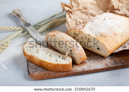 sliced fresh white bread with spices and browned crust, soft focus - stock photo