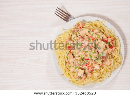 Sliced fried chicken fillet in a creamy sauce. with capellini pasta