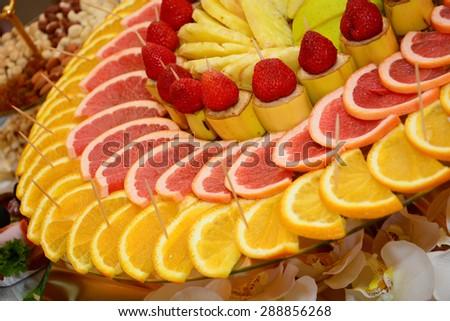 Sliced fruits arrangement - stock photo