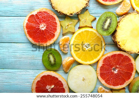 Sliced fruits on table, close-up - stock photo