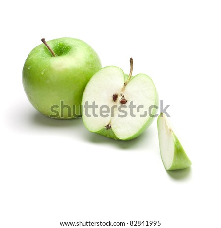 Sliced green apple with drops - stock photo