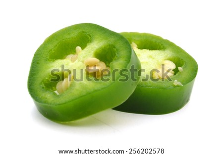 sliced green chilies on white background  - stock photo