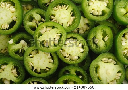 sliced green jalapeno peppers background