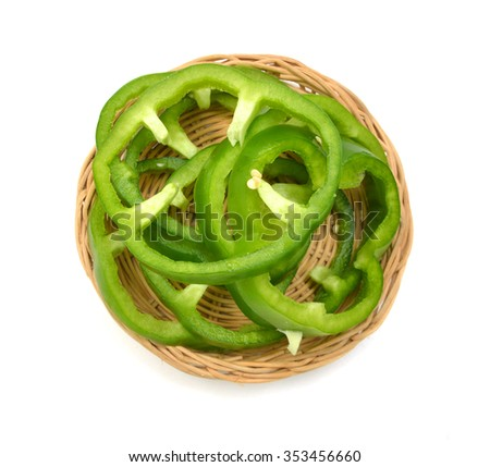 Sliced Green Peppers arranged in basket on white background. - stock photo