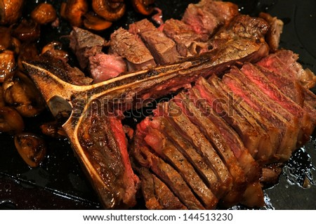 Sliced Grilled T-Bone Steak - stock photo