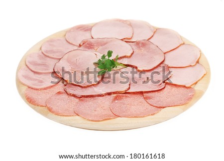 Sliced ham on a cutting board. Isolated on a white background. - stock photo
