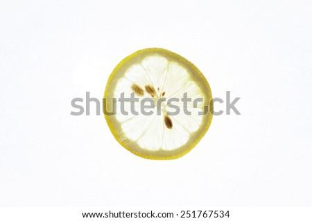Sliced healthy fresh fruits. Ring of lemon  - stock photo