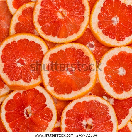 Sliced healthy grapefruit fruits. Red texture