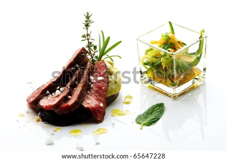 Sliced lamb steak with different vegetable - stock photo