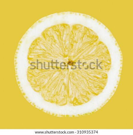 Sliced lemon closeup on yellow background, top view - stock photo