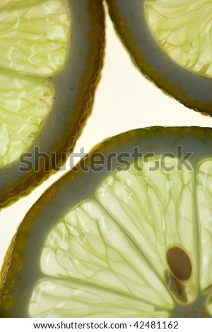 Sliced Lemon isolated on white with backlight