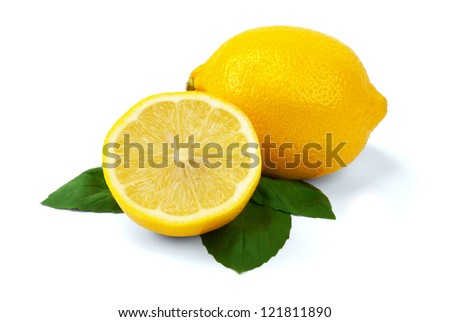 SLICED LEMON WITH GREEN LEAVES ON A WHITE BACKGROUND