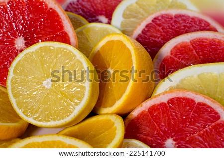 sliced lemons, grapefruit, oranges - stock photo
